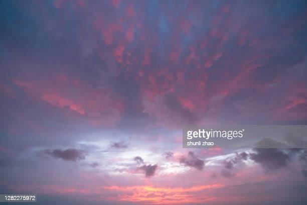 red clouds at sunrise - ロマンチックな空 ストックフォトと画像