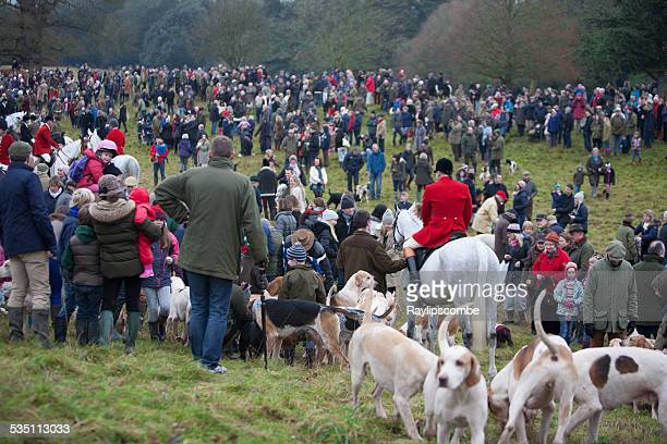red coat huntsman among a group of hunt supporters - boxing day stock photos and pictures