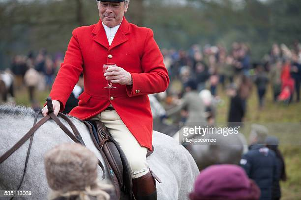 Red Coat Huntsman among a group of hunt supporters