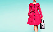 Red coat woman with black leather handbag. Beautiful vintage style.