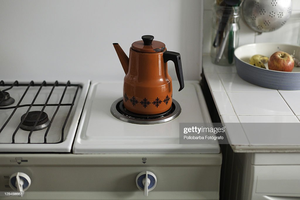 Red coffee pot and fruit : Stock Photo