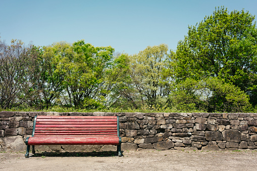 Red color bench in the park on a beautiful spring day - gettyimageskorea