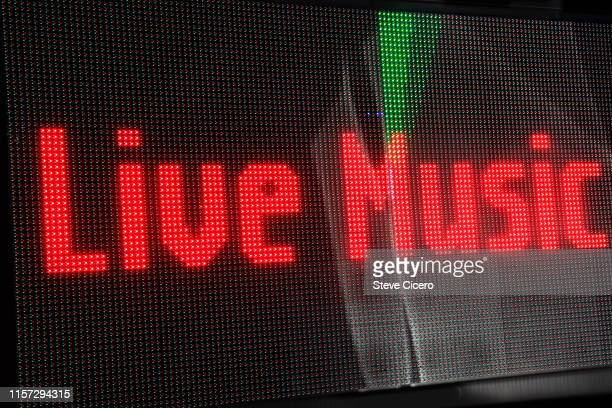 red color type illuminated on led billboard - image stock-fotos und bilder