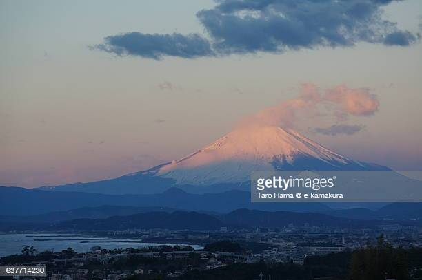 Red colored and snow capped Mt.Fuji in winter
