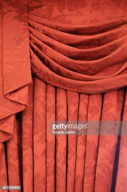 Red colored ornate valance type curtain