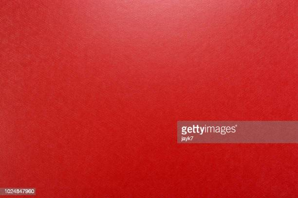red colored paper background - red stock pictures, royalty-free photos & images