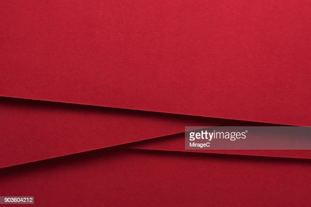 red colored paper crossing - rot stock-fotos und bilder
