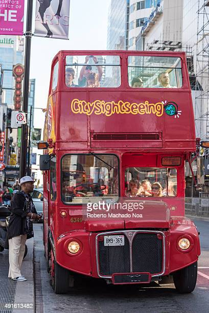 Red colour doubledeck open top City Sightseeing tourist bus in Toronto City sightseeing was started in 1999 in Spain and now has spread to more then...