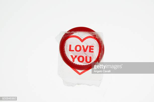Red Condom over Package with Heart