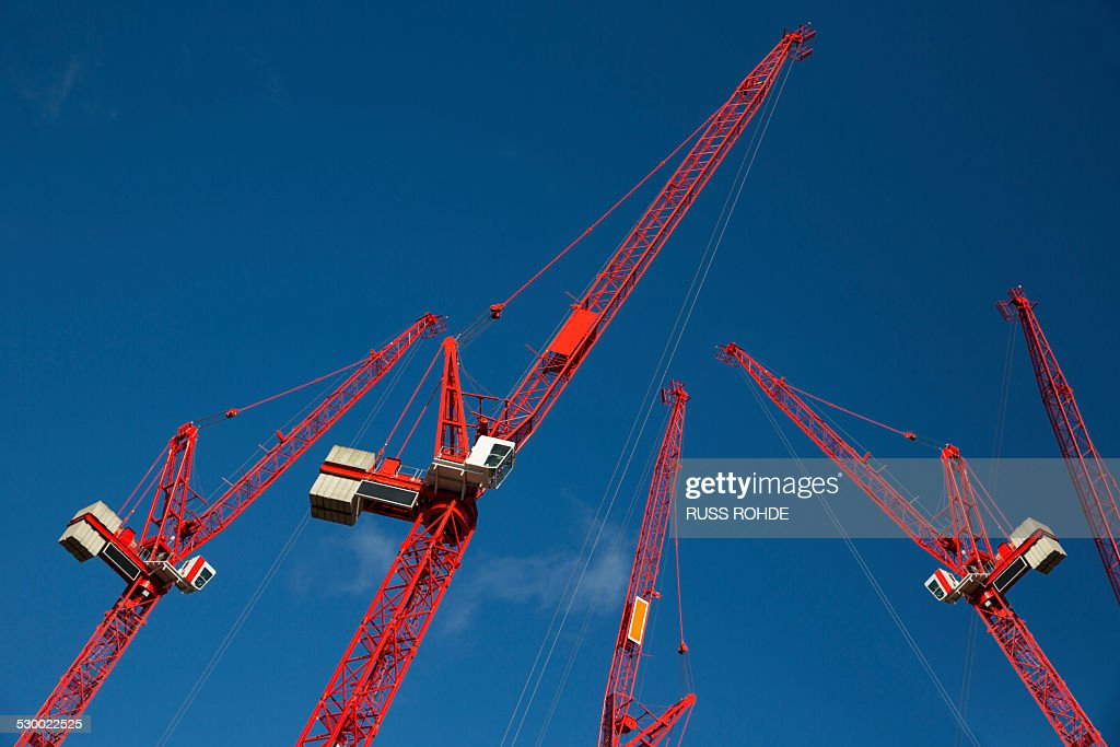 Red construction cranes : Stock Photo