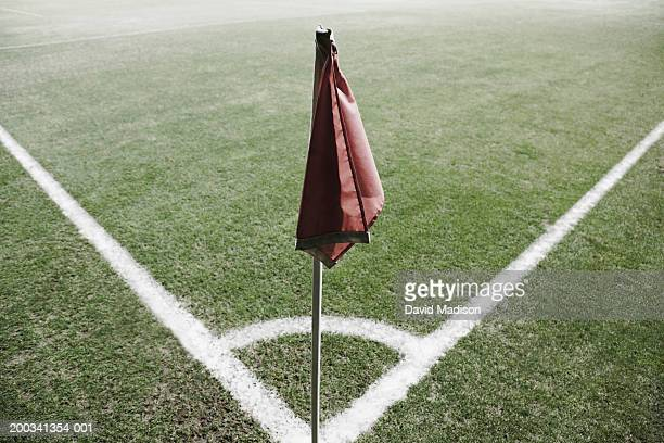 red corner flag on soccer field with marking lines - corner marking stock pictures, royalty-free photos & images