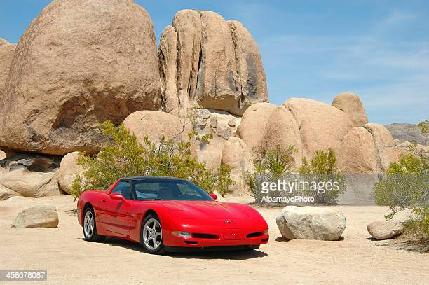 red corvette car in joshua tree national park - chevrolet corvette stock pictures, royalty-free photos & images