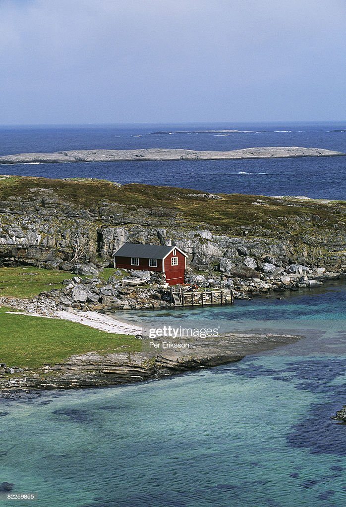 A red cottage by the sea Norway. : Stock Photo