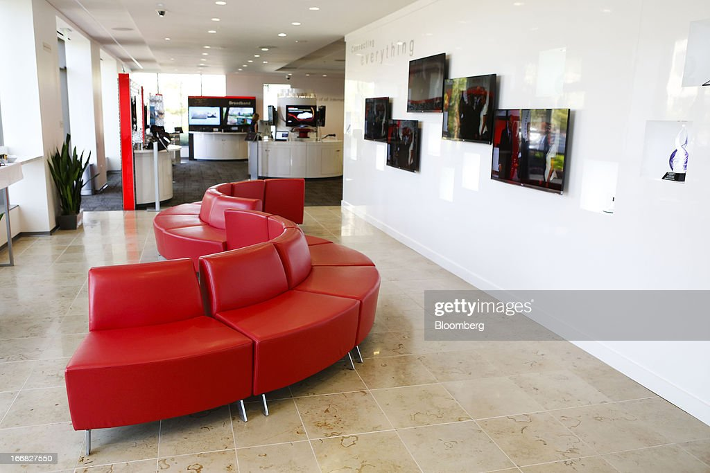 A red couch sits inside the lobby of Broadcom Corp.'s headquarters in Irvine, California, U.S., on Friday, April 12, 2013. Broadcom Corp. designs, develops, and supplies integrated circuits for cable set-top boxes, cable modems, high-speed networking, direct satellite and digital broadcast, and digital subscriber line. Photographer: Patrick Fallon/Bloomberg via Getty Images