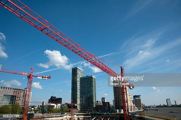 CONTENT] Red cranes amongst a construction site in the Docklands area of London
