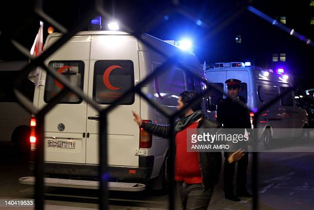 Red Crescent ambulances carrying the remains of American reporter Marie Colvin and French photographer Remi Ochlik who were killed when a makeshift...