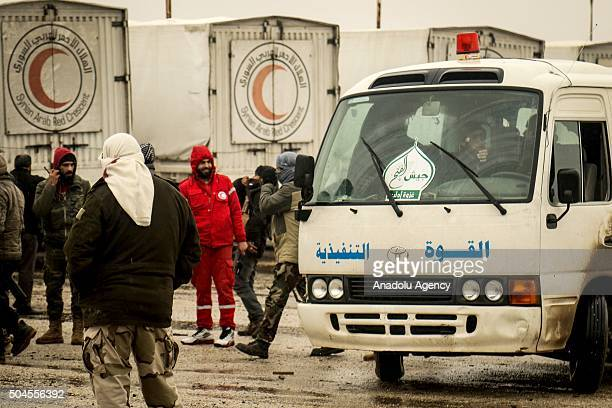 Red Crescent convoy carrying humanitarian aid pass along the road in Fu'ah town of Idlb Syria on January 11 2016 Opposition let the convoy to the...