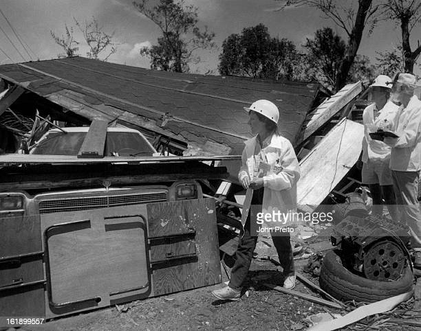 JUN 17 1988 Red Cross adjusters checking over the damage at this home two cars inside a garage that collapsed on then L to R Sue Bell Ran Beard Lyle...