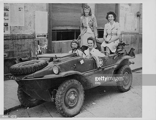 Red Cross girls using a captured German amphibious vehicle during World War Two; Leonora Kirley, Frances Shepherd, Peggy Kimball and Marcia Hinrichs,...