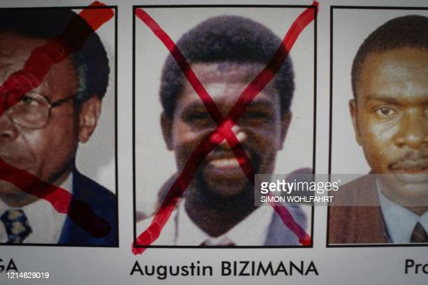 A red cross is seen drawn on the face of Augustin Bizimana one of the mostwanted fugitives from the 1994 Rwandan genocide on a wanted poster at the...