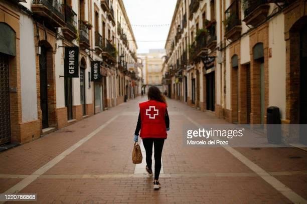 Red Cross member Granada de la Rosa walks to deliver a free meal on April 24, 2020 in Huelva, Spain. Xanty Elias supported by his team and volunteers...