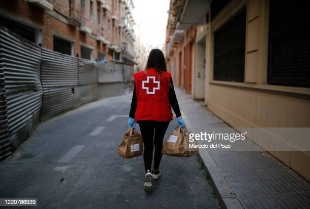Red Cross member Granada de la Rosa walks to deliver free meals on April 24 2020 in Huelva Spain Xanty Elias supported by his team and volunteers are...