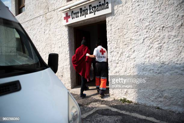 Red Cross member helps a Sub Saharan migrant to get into the Red Cross building 50 men and 5 women were rescued in Alboran Sea from a dinghy and...