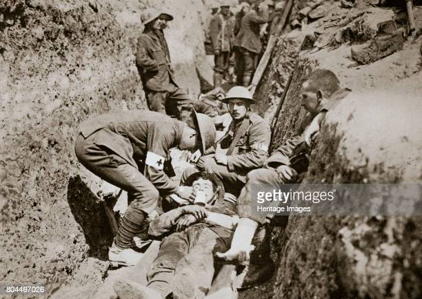 Red Cross men in the trenches tend a wounded man Somme campaign France World War I 1916 Artist Unknown