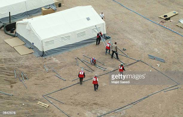 Red Cross officials set up their camp after last week's earthquake in this aerial view January 3 2004 in Bam Iran The death toll from the 66magnitude...