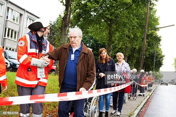 red cross operation - evacuation stock pictures, royalty-free photos & images