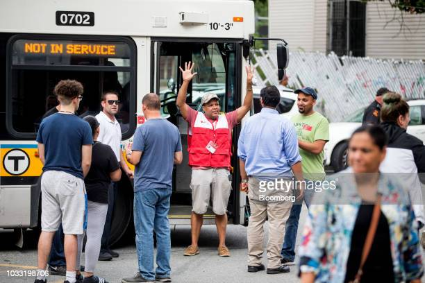A Red Cross representative gathers evacuees outside of a Red Cross shelter at Arlington Middle School in Lawrence Massachusetts US on Friday Sept 14...