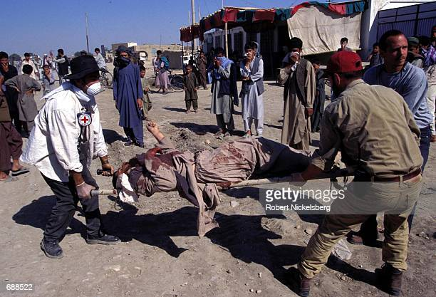 Red Cross staff collect the bodies of dead Taliban soldiers killed over a twoday fight by local antiTaliban forces of the Northern Alliance loyal to...