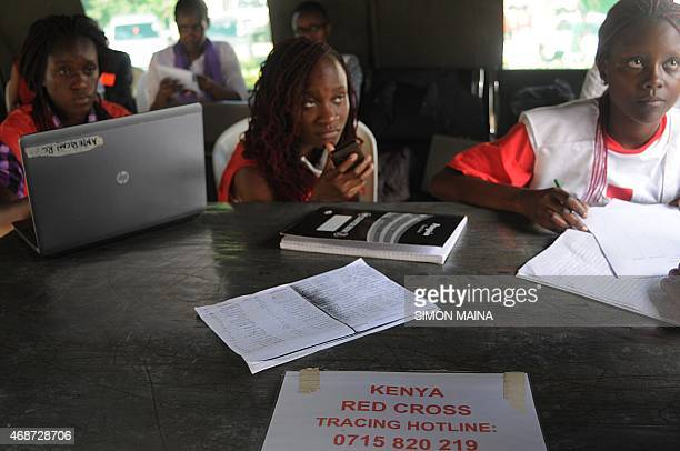 Red Cross staff get instructions on April 6 2015 on how to assist relatives of victims at a funeral parlor in Nairobi following the April 2 attack on...