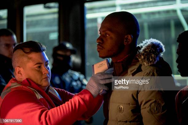A red cross staff taking the temperature of a rescued migrant on November 28 Malaga