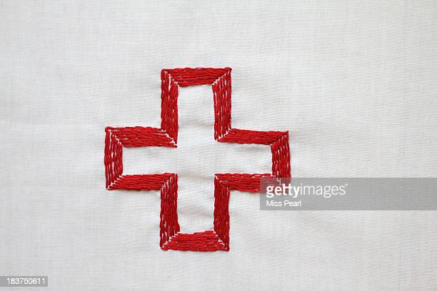 Red cross symbol embroidery illustration