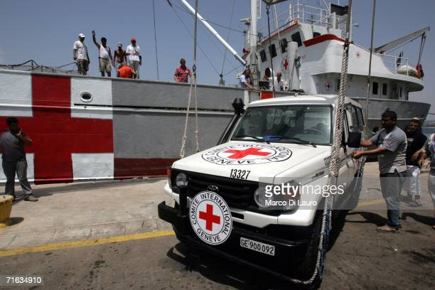 A red Cross vehicle is unloaded from the International Committee of the Red Cross ship Georgios K at the city port on August 12 2006 in Tyre Southern...