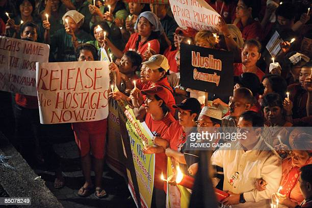 Red Cross volunteers and sympathizers led by Philippine National Red Cross chairman Senator Richard Gordon hold a candlelight prayer rally in Quezon...