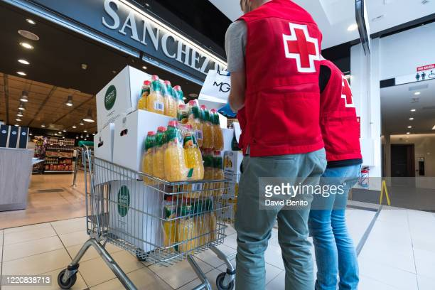 Red Cross volunteers are seen collecting the donation from the commercial center La Moraleja Green on April 24 2020 in Madrid Spain Starting last...