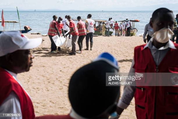 Red Cross volunteers from Goma and Gisenyi intervene on the municipal beach of Gisenyi, northeast Rwanda on April 20 and load the bodies of people...