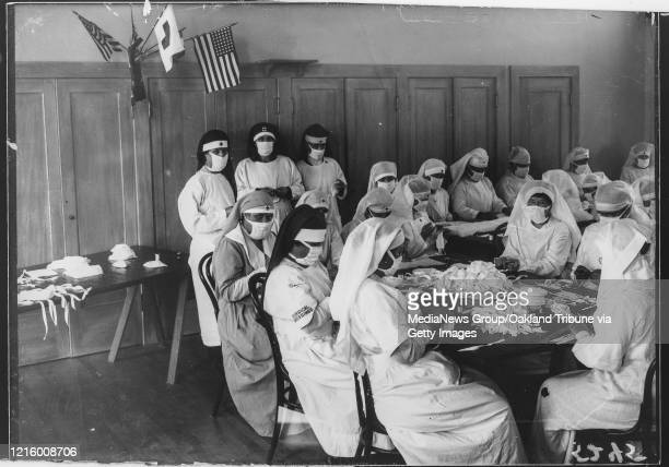 OCTOBER 1918 Red Cross volunteers from the Piedmont Chapter of the Red Cross create masks during the Spanish Flu pandemic