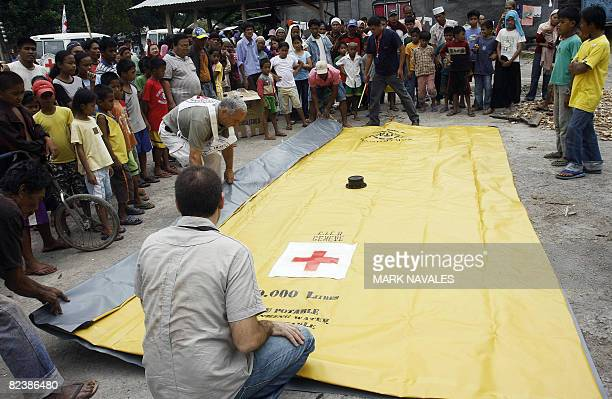 Red Cross volunteers set up a water bladder at a government evacuation center in Pikit town North Cotabato on August 16 2008 as most of the displaced...