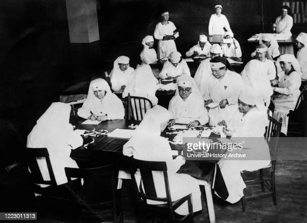 Red Cross Women at the New York County Chapter at the workroom at 82nd street and Amsterdam Ave., turning out Medical Supplies and Hospital Equipment...