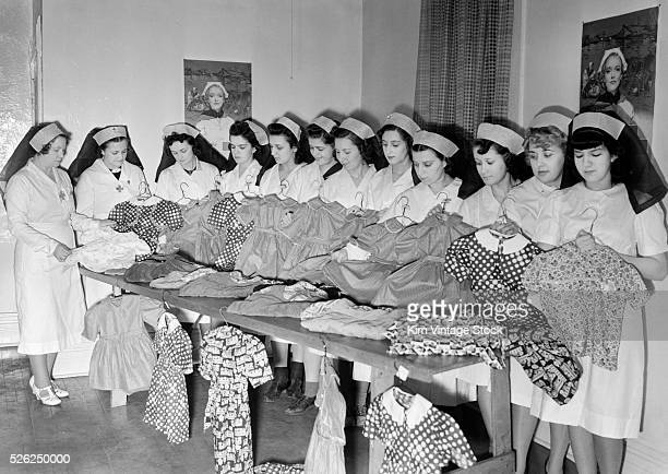 Red Cross women sewing dresses for War refugee relief, ca. 1944