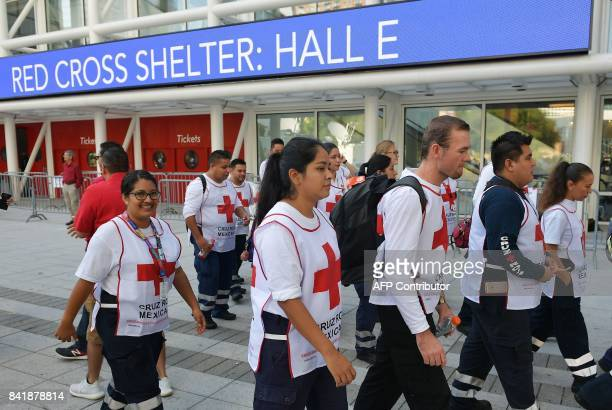 Red Cross workers from Mexico arrive at the George R Brown Convention Center which has been a shelter for evacuees from Hurricane Harvey in Houston...