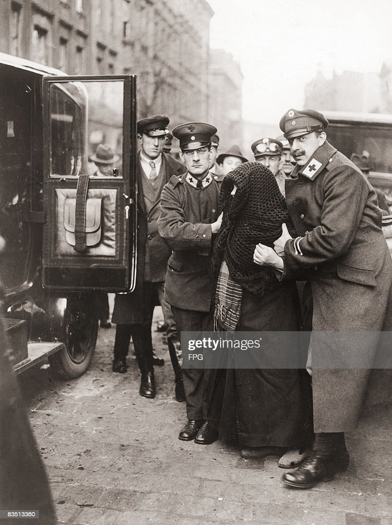 Red Cross workers helping an elderly woman into a car, which will take her to vote in the Upper Silesia plebiscite on self-determination for the Province of Upper Silesia, Weimar Germany, 20th March 1921. The plebiscite was a requirement of the Treaty of Versailles and disputes over the results led to the outbreak of the Third Silesian Uprising between May and June.