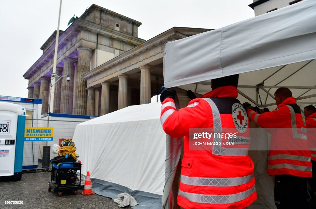 Red Cross workers set up an emergency tent in front of Berlinu0027s landmark Brandenburg Gate where : tent gate - memphite.com