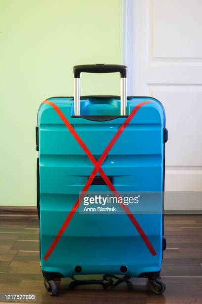 red crossed tape over suitcase. concept of tourism restriction, flights cancellation, travel bans due to coronavirus pandemic - forbidden stock pictures, royalty-free photos & images