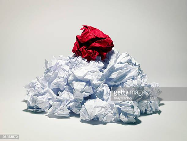 Red Crumpled Paper on White Paper.