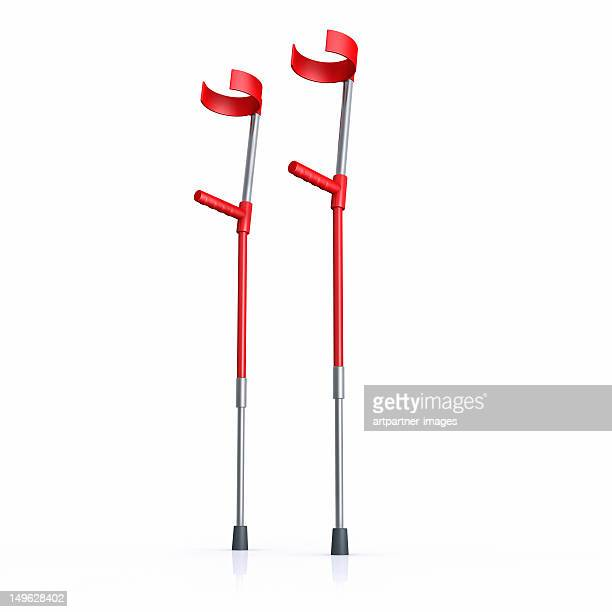 red crutches on a white background - 杖 ストックフォトと画像