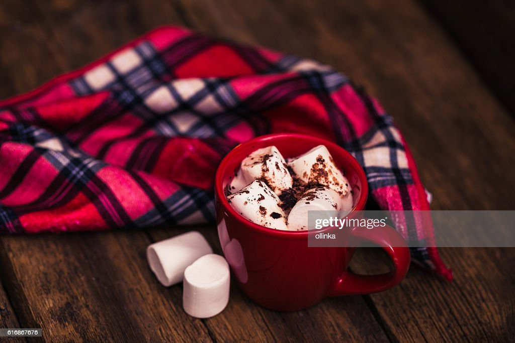 red cup with cocoa and marshmallows on the wooden background : Stock Photo
